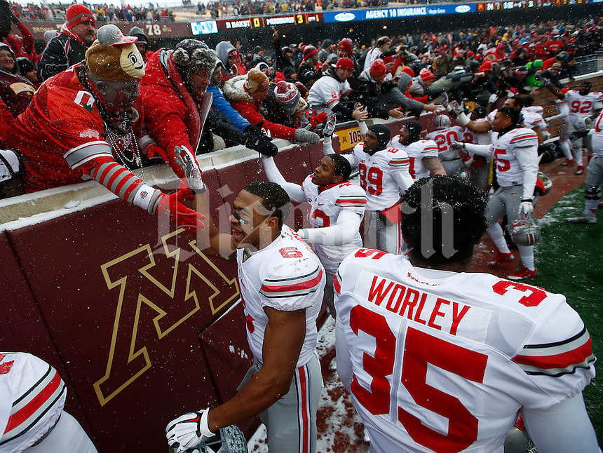 The Ohio State Buckeyes celebrate after the college football game between the Ohio State Buckeyes and the Minnesota Golden Gophers at TCF Bank Stadium in Minneapolis, Saturday morning, November 15, 2014. The Ohio State Buckeyes defeated the Minnesota Golden Gophers 31 - 24. (The Columbus Dispatch / Eamon Queeney)