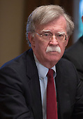 National Security Advisor John  Bolton listens to President Donald J. Trump make statements on the ongoing investigation of  election meddling and on the current situation in Syria during a meeting with senior military leadership at The White House in Washington, DC, March 9, 2018. Credit: Chris Kleponis / CNP