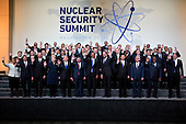 United States President Barack Obama, center, waves among other heads of state and attendees during a family photo at the Nuclear Security Summit in Washington, D.C., U.S., on Friday, April 1, 2016. After a spate of terrorist attacks from Europe to Africa, Obama is rallying international support during the summit for an effort to keep Islamic State and similar groups from obtaining nuclear material and other weapons of mass destruction. <br /> Credit: Andrew Harrer / Pool via CNP