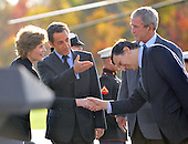 Camp David, MD - October 18, 2008 --  United States President George W. Bush and first lady Laura Bush welcome President Nicolas Sarkozy of France, who also serves as this year's rotating President of the European Union (EU), left center, introduces President José Manuel Barroso of the European Commission (EC), right, to first lady Laura Bush, left, at the Presidential Retreat near Thurmont, Maryland for talks on Saturday, October 18, 2008.  The two European leaders stopped at Camp David to meet with President Bush to discuss the economy on their way home from a summit in Canada to try to convince Bush to support a summit by year's end to try to reform the world financial system.  United States President George W. Bush looks on from right..Credit: Ron Sachs / Pool via CNP