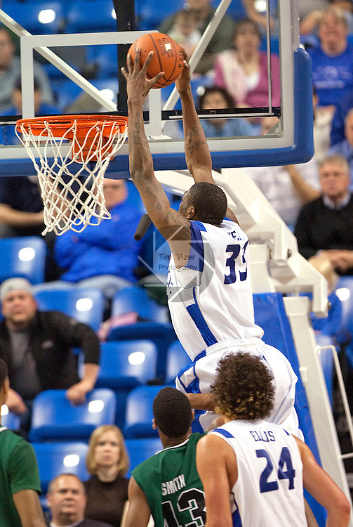 March 22,  2010                                    Saint Louis forward Willie Reed (33) dunks in the second half.  In foreground is teammate Saint Louis forward Cody Ellis (24).  St. Louis University defeated the University of Wisconsin-Green Bay  68-62 in double overtime in a quarterfinal (second) round game of the College Basketball Invitational Tournament on Monday March 22, 2010 at Saint Louis University's Chaifetz Arena.