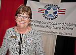 Jennifer M. Cernock, President of the Texas Chapter of Operation Homefront of smiles at her booth at Texas at the Eleventh Annual Texas Conference for Women