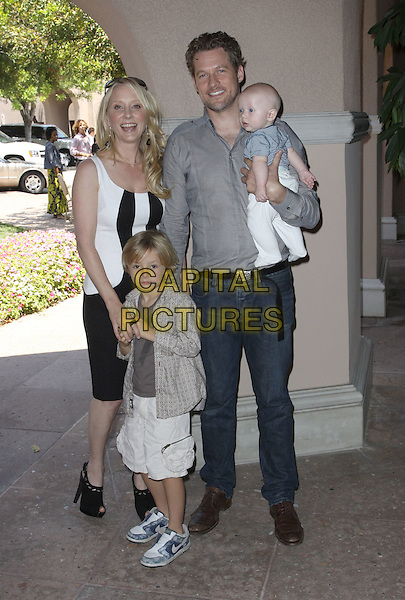 ANNE HECHE, JAMES TUPPER & CHILDREN.2009 Cable's Summer Press Tour_Day3 Held at The Langham Huntington Hotel & Spa, Pasadena, California, USA..July 30th, 2009.full length black white dress couple kids carrying jeans denim grey gray.CAP/ADM/KB.©Kevan Brooks/AdMedia/Capital Pictures.