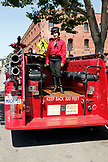 USA, California, San Francisco, a woman prepares to take tourists across the Golden Gate Bridge on an old restored firetruck, located at the end of Columbus Avenue