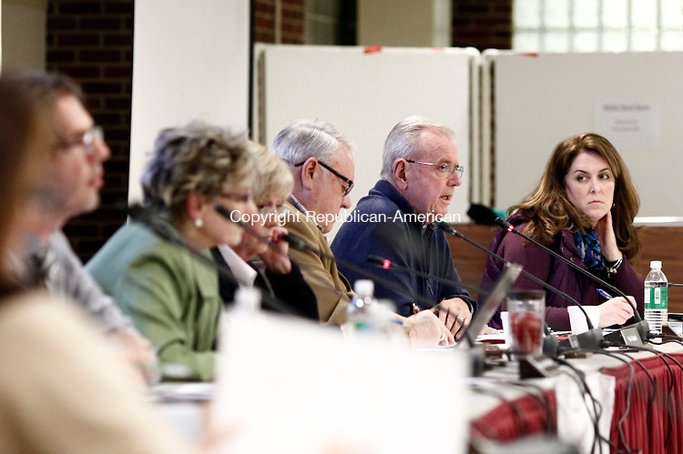Southbury, CT- 07 April 2014-040714CM04-  Pomperaug Region School District 15 board of education member, Fran Brennan, second from right, addresses members of the community during a public hearing on its proposed budget at Pomperaug High School in Southbury on Monday.  Looking on at right is board member, Jennifer Connelly.   Christopher Massa Republican-American