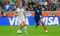Christie Rampone (l) of team USA and Marie-Laure Delie of team France during the FIFA Women's World Cup at the FIFA Stadium in Moenchengladbach, Germany on July 13th, 2011.