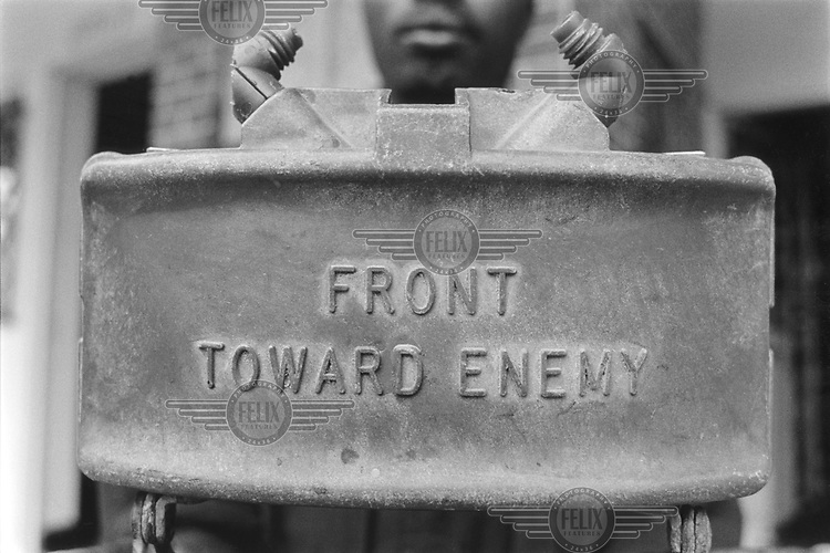 © Crispin Hughes / Panos Pictures..Huambo, ANGOLA..De-mining engineer with a 'Claymore' landmine, imported from the USA. It is designed to spray 700 steel balls in a fan-shaped 60 degree arc and can be used for defence or ambush purposes.