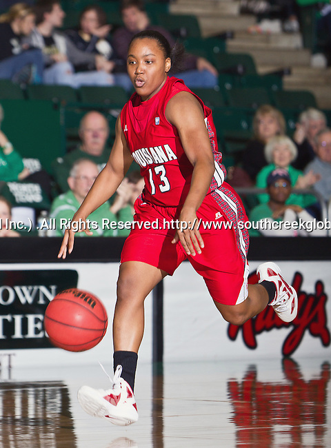 Louisiana Lafayette Ragin' Cajuns guard Krystal Motley (13) in action during the game between the Louisiana Lafayette Ragin' Cajuns and the University of North Texas Mean Green at the North Texas Coliseum,the Super Pit, in Denton, Texas. UNT defeats Louisiana Lafayette 78 to 40....