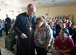 Cardinal Timothy Dolan, the archbishop of New York, embraces Amal Mare during a visit to a camp for internally displaced families in Ankawa, near Erbil, Iraq, on April 9, 2016. Dolan, chair of the Catholic Near East Welfare Association, is in Iraqi Kurdistan with other church leaders to visit with Christians and others displaced by ISIS. Mare broke down while asking Dolan how long it would be until she and her family could return to their home in Qaraqosh. She said they had been praying the rosary every night, but were tired of living in misery and wanted to go home.