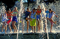 Teenage girls playing in the fountain at Kapiolani park
