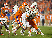 Charlotte, NC - December 2, 2017: Miami Hurricanes quarterback Malik Rosier (12) gets sacked during the ACC championship game between Miami and Clemson at Bank of America Stadium in Charlotte, NC. Clemson defeated Miami 38-3 for their third consecutive championship title. (Photo by Elliott Brown/Media Images International)