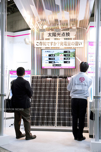 """December 13, 2012, Tokyo, Japan - Visitor and exhibitor see the solar panel at Eco-Products Exhibition. The Eco-Products Exhibition is one of the biggest environmental issues in Japan, drawing more than 180,000 business people and consumer exhibitors. The theme of this year is """"The Greener, The Smaller - The Future We Will Choose"""", the exhibition will be held from December 13th to 15th in Tokyo Big Sight.(Photo by Rodrigo Reyes Marin/AFLO).."""