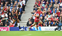 Wales's Lee Williams starts to celebrate before scoring his sides second try<br /> <br /> Kenya Vs Wales - men's placing 5-8 match<br /> <br /> Photographer Chris Vaughan/CameraSport<br /> <br /> 20th Commonwealth Games - Day 4 - Sunday 27th July 2014 - Rugby Sevens - Ibrox Stadium - Glasgow - UK<br /> <br /> © CameraSport - 43 Linden Ave. Countesthorpe. Leicester. England. LE8 5PG - Tel: +44 (0) 116 277 4147 - admin@camerasport.com - www.camerasport.com