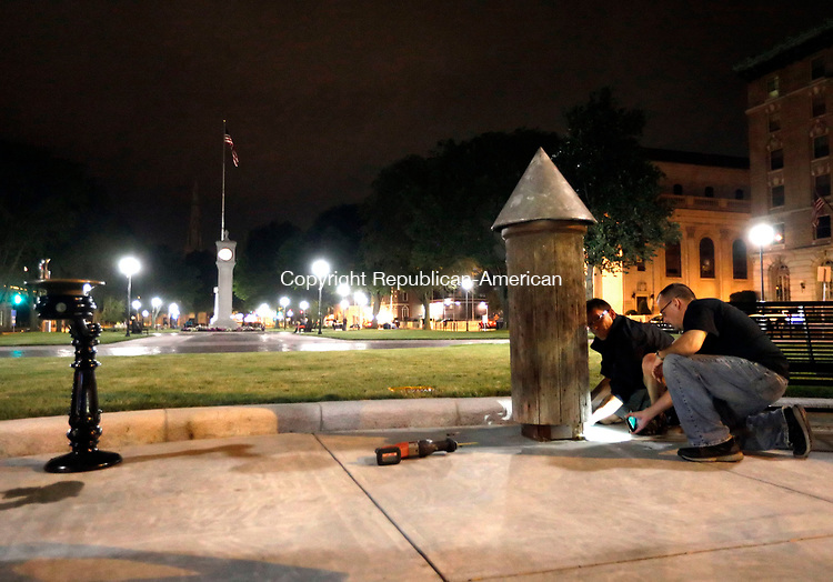 Waterbury, CT- 27 July 2017-072717CM04-   Waterbury Department of Public Works employees remove a post on the City green on Thursday night.  The post which has caused controversy in recent time was removed and taken away from the green.        Christopher Massa Republican-American