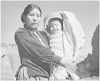 """""""Diné Woman and Infant, Canyon de Chelle, Arizona."""" [Canyon de Chelly National Monument];<br /> From the series Ansel Adams Photographs of National Parks and Monuments, compiled 1941 - 1942, documenting the period ca. 1933 - 1942."""