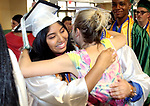 WATERBURY CT. 21 June 2017-062117SV10-Gail Leon, 18, gets a hug from Stephanie LaBonte, teacher, during the Wilby High Graduation in Waterbury Wednesday. <br /> Steven Valenti Republican-American