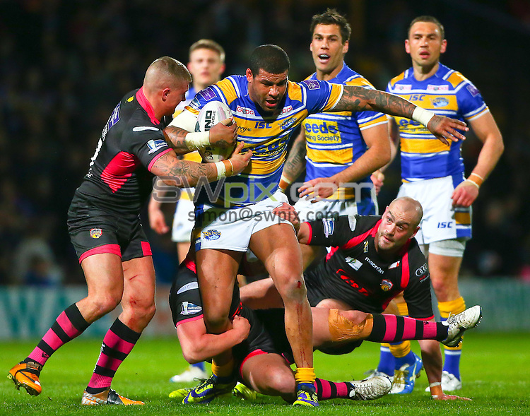 Picture by Alex Whitehead/SWpix.com - 11/04/2014 - Rugby League - First Utility Super League - Leeds Rhinos v Wakefield Wildcats - Headingley Stadium, Leeds, England - Leeds' Ryan Bailey is tackled by Wakefield's defence.