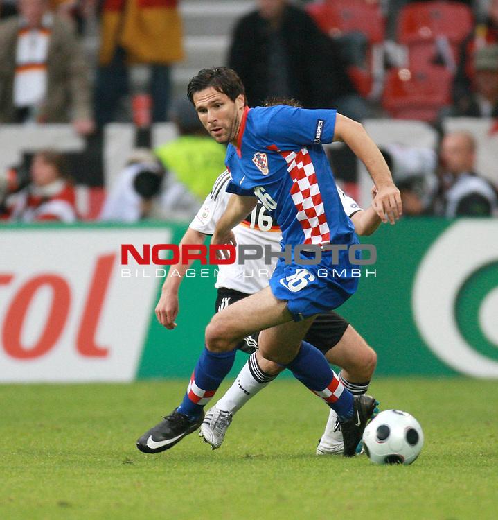 UEFA Euro 2008 Group B Klagenfurt - W&ouml;rthersee Match 11  Stadion Woerthersee<br /> Kroatien ( CRO ) - Deutschland ( GER ) 2:1 ( 1:0)<br /> <br /> Jerko Leko ( Croatia / Mittelfeldspieler / Midfielder / AS Monaco #16 ) gegen Philipp Lahm ( Germany  / Verteidiger / Defender / Bayern Muenchen #16) <br /> <br /> Foto &copy; nph (  nordphoto  )<br /> <br /> <br /> <br />  *** Local Caption ***