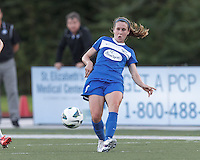 Boston Breakers midfielder Heather O'Reilly (9) passes the ball.  In a National Women's Soccer League (NWSL) match, Boston Breakers (blue) defeated FC Kansas City (white), 1-0, at Dilboy Stadium on August 10, 2013.