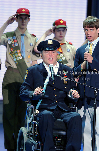 New York, NY - August  30, 2004 --  Sergeant Steven McDonald of New York, NY, center, a New York City police officer wounded in the line of duty, leads the Pledge of Allegiance at the 2004 Republican National Convention in New York, New York on Monday, August 30, 2004.  Sergeant McDonald was wounded by a teen-age assailant in Central Park, New York in July, 1986.   Behind Mr. McDonald are representatives from the Boy Scouts of America.Credit: Ron Sachs / CNP  .(RESTRICTION: No New York Metro or other Newspapers within a 75 mile radius of New York City)