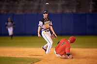 Wisconsin-Milwaukee Panthers second baseman Billy Quirke (7) throws to first base as Scott Tyler (7) slides in during a game against the Ball State Cardinals on February 26, 2016 at Chain of Lakes Stadium in Winter Haven, Florida.  Ball State defeated Wisconsin-Milwaukee 11-5.  (Mike Janes/Four Seam Images)