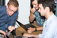 Aaron Dennis (from left), Daniel McGlone, and Max Gardner, work on tool for calculating voting district compactness at the Metric Geometry and Gerrymandering Group (MGGG) hackathon at the Data Lab in the Tisch Library at Tufts University in Medford, Massachusetts, USA, on Thurs., Aug. 10, 2017. Dennis, 22, is a Database Specialist at Azavea in Philadelphia, Pennsylvania. McGlone, 32, is a GIS Analyst at Azavea in Philadelphia, Pennsylvania. Gardner, 29, of Oakland, Calif., is a Ph.D. student studying Civil Engineering at the University of California, Berkeley. The hackathon is part of the first in a series of Geometry of Redistricting workshops put on by the MGGG. Academics, Geographic Information Systems (GIS) professionals, and legal professionals worked together to build tools useful in analyzing voting district data around the country.