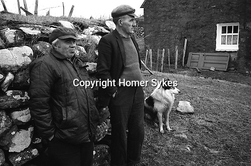 Shetlands, Two men and a sheep dog passing the time of day,  Carloway, Isle of Lewis, Outer Hebrides, Scotland 1974