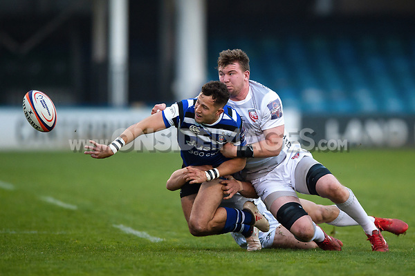 Max Green of Bath United offloads the ball after being tackled. Premiership Rugby Shield match, between Bath United and Gloucester United on April 8, 2019 at the Recreation Ground in Bath, England. Photo by: Patrick Khachfe / Onside Images