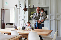 Alex Willcock and his children in their kitchen
