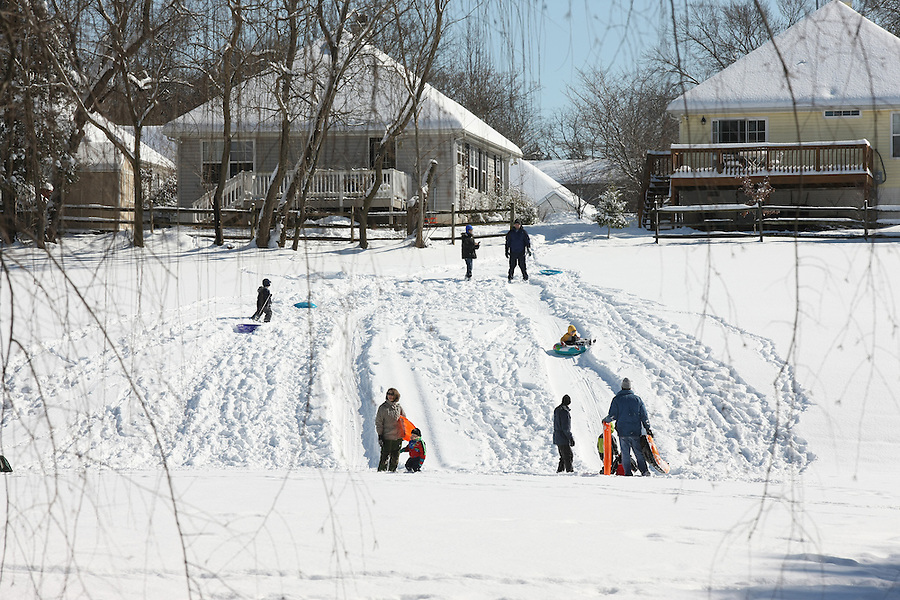Children enjoy playing on the snow in Charlottesville, VA.