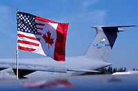 Friendship Flag, Unofficial Flag uniting American and Canadian National Flags - at Abbotsford International Airshow, BC, British Columbia, Canada - Lockheed C-5 Galaxy Cargo Transporter in background