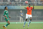 07 August 2008: Kew Jaliens (NED) (4) heads the ball in front of Peter Odemwingie (NGA) (14).  The men's Olympic soccer team of the Netherlands played the men's Olympic soccer team of Nigeria at Tianjin Olympic Center Stadium in Tianjin, China in a Group B round-robin match in the Men's Olympic Football competition.