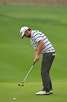 Andy Sullivan (ENG) putts on the 16th green during Friday's Round 2 of the 2014 BMW Masters held at Lake Malaren, Shanghai, China 31st October 2014.<br /> Picture: Eoin Clarke www.golffile.ie
