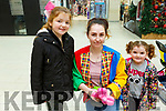 Kayla and Megan Gleeson from Ballyheigue with Rosemarie Kelliher from Killorglin who is making toy poodles with the balloons in the Manor West Shopping Centre on Saturday.