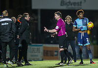 Referee Lee Collins has words with Newport County Manager Graham Westley during the Sky Bet League 2 match between Wycombe Wanderers and Newport County at Adams Park, High Wycombe, England on 2 January 2017. Photo by Andy Rowland.