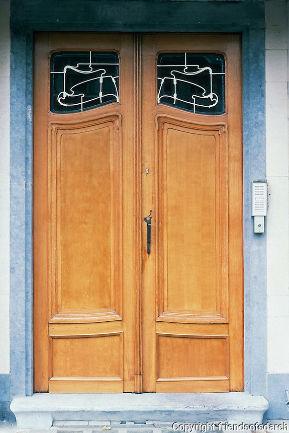 Victor Horta: Hotel Van Eetveld, Brussels. Detail of entry door--iron and glass inserts.