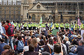 Police officers cordon off the Houses of Parliament as Extinction Rebellion climate change campaigners marching from Marble Arch arrive at Parliament Square, London.