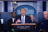 United States President Donald J. Trump makes remarks on the Coronavirus crisis in the Brady Press Briefing Room of the White House in Washington, DC on Saturday, March 21, 2020.  Standing behind the President, from left to right: US Secretary of Housing and Urban Development (HUD) Ben Carson; Director of the National Institute of Allergy and Infectious Diseases at the National Institutes of Health Dr. Anthony Fauci; and Admiral Brett Giroir, US Assistant Secretary for Health.<br /> Credit: Stefani Reynolds / Pool via CNP/AdMedia