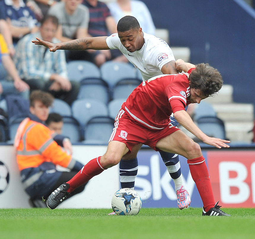 Preston North End's Chris Humphrey battles with  Middlesbrough's Diego Fabbrini<br /> <br /> Photographer Dave Howarth/CameraSport<br /> <br /> Football - The Football League Sky Bet Championship - Preston North End v Middlesbrough -  Sunday 9th August 2015 - Deepdale - Preston<br /> <br /> &copy; CameraSport - 43 Linden Ave. Countesthorpe. Leicester. England. LE8 5PG - Tel: +44 (0) 116 277 4147 - admin@camerasport.com - www.camerasport.com
