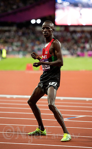 05 AUG 2012 - LONDON, GBR - Ezekiel Kemboi (KEN) of Kenya celebrates winning the men's 3000m Steeplechase final during the London 2012 Olympic Games athletics in the Olympic Stadium at the Olympic Park in Stratford, London, Great Britain .(PHOTO (C) 2012 NIGEL FARROW)