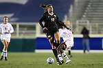 02 November 2012: Wake Forest's Katie Stengel limps away from a challenge. The Wake Forest University Demon Deacons played the University of Maryland Terrapins at WakeMed Stadium in Cary, North Carolina in a 2012 NCAA Division I Women's Soccer and Atlantic Coast Conference Tournament semifinal game. Maryland won the game 2-0.