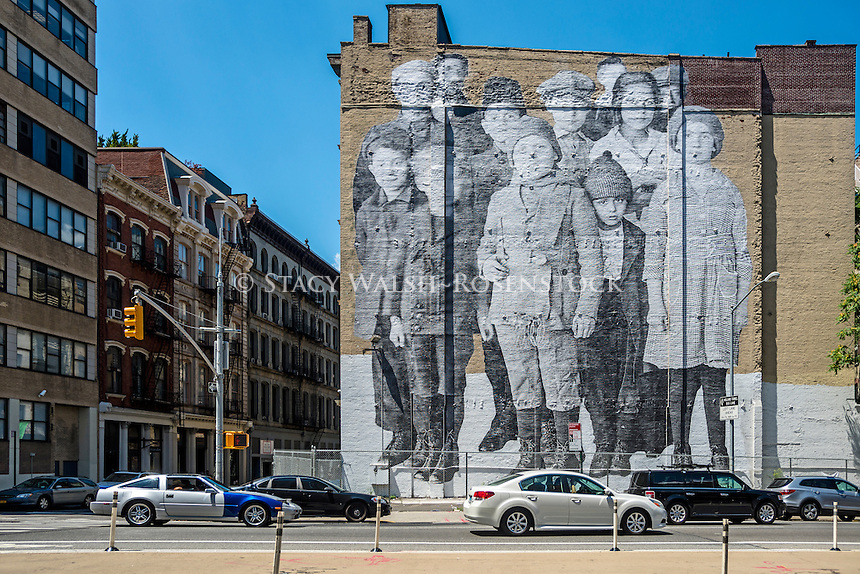"""New York, USA - Street Mural entitled """"Ellis Island"""" a tribute, by French Aetist JR,  to the millions of Immigrants who passed through Ellis Island."""
