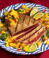 Tuna with tropical salsa and limes.