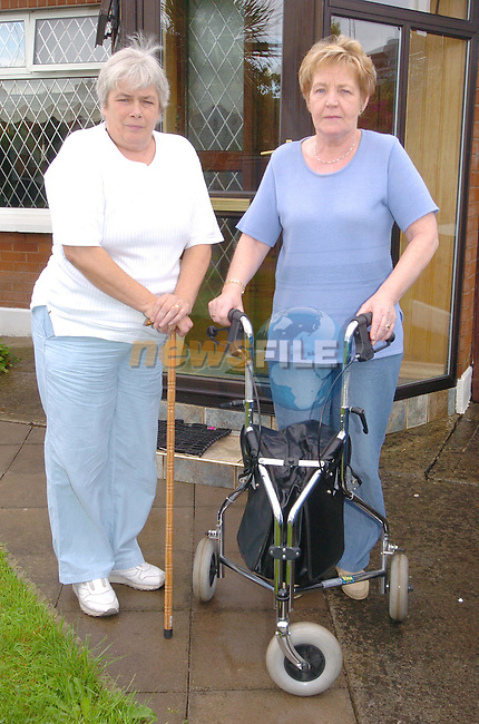 Asumpta Owens and Terese Fagan who had to walk for a half mile to get a wheel chair from Ryan Air.Photo Fran Caffrey Newsfile.ie..This Picture has been sent to you by Newsfile Ltd..The Studio,.Millmount Abbey,.Drogheda,.Co. Meath,.Ireland..Tel: +353(0)41-9871240.Fax: +353(0)41-9871260.ISDN: +353(0)41-9871010.www.newsfile.ie..general email: pictures@newsfile.ie
