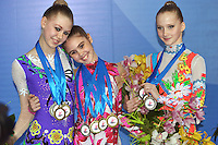 (L-R) Hanna Rabtsava of Belarus (silver), Alexandra Merkulova of Russia (gold) and Aliaksandra Narkevich of Belarus (bronze) win all the medals in junior All Around (01May) and Event Finals at 2009 Pesaro World Cup on May 2, 2009 at Pesaro, Italy.  Photo by Tom Theobald.