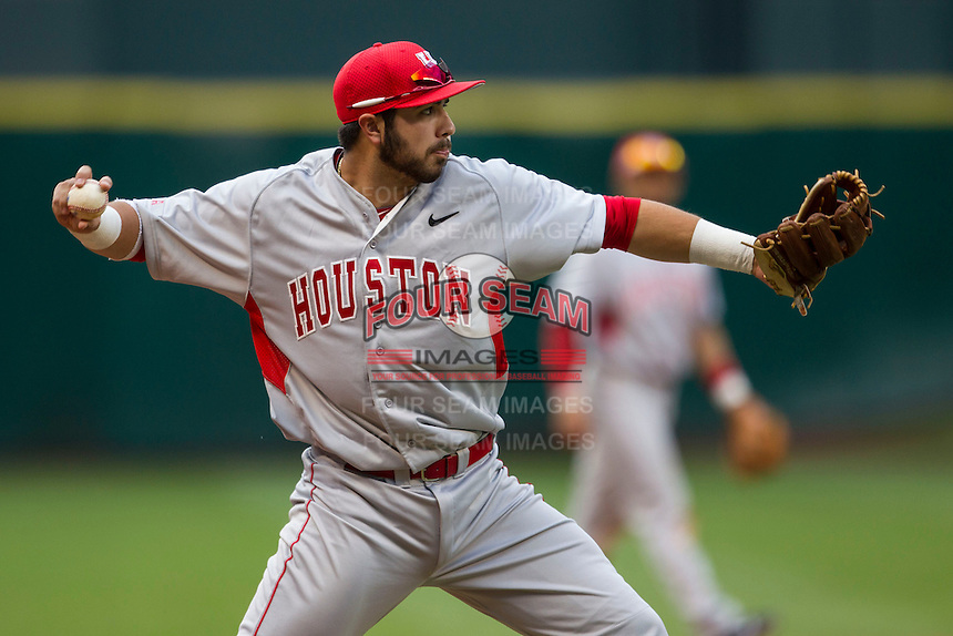 Houston Cougars third baseman Justin Montemayor #20 makes a throw to first base during the NCAA baseball game against the Texas Longhorns on March 1, 2014 during the Houston College Classic at Minute Maid Park in Houston, Texas. The Longhorns defeated the Cougars 3-2. (Andrew Woolley/Four Seam Images)