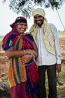Fairtrade cotton farmer Sugna Jat, 30, gets ready to pick cotton together with her husband, Nandaram Jat, 40, in their farm in Maheshwar, Khargone, Madhya Pradesh, India on 13 November 2014. Sugna and Nandaram do the farming together and hire labourers at a fair wage when they need to. Photo by Suzanne Lee for Fairtrade