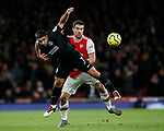 Arsenal's Sokratis tussles with Brighton's Neal Maupay during the Premier League match at the Emirates Stadium, London. Picture date: 5th December 2019. Picture credit should read: David Klein/Sportimage