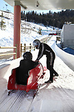 USA, Utah, Park City, a two man bobsled team at the finish line, Utah Olympic Park
