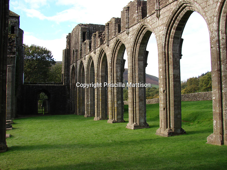 Llanthony, Wales - November 2, 2006: A row of arches at the ruins of Llanthony Priory indicates the scale of the structure.